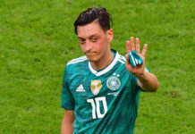 Arsenal's Mesut Ozil quits German team after racism scandal