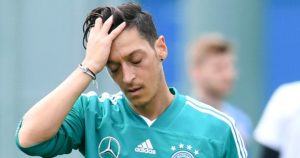 Arsenal's Mesut Ozil quits German team after racism scandal
